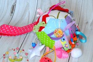 Развивающая игрушка-мячик для малыша - Опис