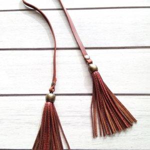 Кожаные украшения для сумок