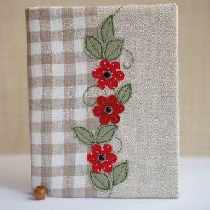 Работа Блокнот Льон та червоні квіти.